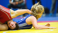 11 MAY 2014 - SHEFFIELD, GBR - Chloe Spiteri (left) attempts to overpower Liz Kay during their women's 63kg category freestyle match at the British 2014 Senior Wrestling Championships in EIS in Sheffield, Great Britain  (PHOTO COPYRIGHT © 2014 NIGEL FARROW, ALL RIGHTS RESERVED)
