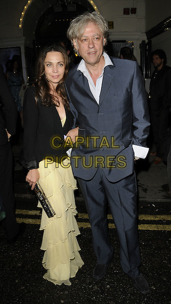 """JEANNE MARINE & Sir BOB GELDOF.""""Ghost The Musical"""" press night, Piccadilly Theatre, Denman St., London, England..July 19th, 2011.full length black jacket yellow layered layers dress blue suit white shirt couple.CAP/CAN.©Can Nguyen/Capital Pictures."""