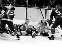Seals vs. LA Kings:Seals Norm Ferguson and Carol Vadnais attack goalie Wayne Rutledge..(1969  photo by Ron Riesterer)