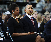 Fort Hood, TX - November 10, 2009 -- U.S. President Barack Obama sits with his wife First Lady Michelle Obama during the memorial service for the 12 soldiers and one civilian killed at Fort Hood U.S Army Post near Killeen, Texas, USA 10 November 2009. Army Major Malik Nadal Hasan reportedly shot and killed 13 people, 12 soldiers and one civilian, and wounded 30 others in a rampage 05 November at the base's Soldier Readiness Center where deploying and returning soldiers undergo medical screenings.  .Credit: Tannen Maury / Pool via CNP