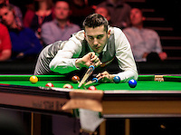 Mark Selby uses a rest to take his shot during the Dafabet Masters Quarter Final 3 match between Ronnie O'Sullivan and Mark Selby at Alexandra Palace, London, England on 14 January 2016. Photo by Liam Smith / PRiME Media Images