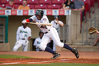 Cedar Rapids Kernels outfielder J.D. Williams #2 attempts to bunt during a game against the Lansing Lugnuts at Veterans Memorial Stadium on April 29, 2013 in Cedar Rapids, Iowa. (Brace Hemmelgarn/Four Seam Images)