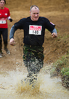 06 FEB 2011 - SIBBERTOFT, GBR - Martin Exley makes his way through the pond during the Avalanche Adventure Run .(PHOTO (C) NIGEL FARROW)