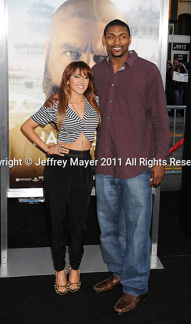 """`HOLLYWOOD, CA - MAY 19: Ron Artest and guest arrive at the Los Angeles premiere of """"The Hangover Part II"""" at Grauman's Chinese Theatre on May 19, 2011 in Hollywood, California."""
