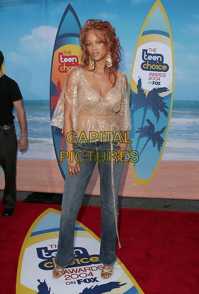 TYRA BANKS.The 2004 Teen Choice Awards held at The Universal Ampitheatre in Universal City, California .August 8, 2004.full length, jeans, denim, lace, see though, see thru top.www.capitalpictures.com.sales@capitalpictures.com.Supplied By Capital Pictures