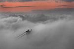 The San Francisco fog tops the Golden Gate Bridge of San Francisco, California.