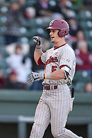 Center fielder TJ Hopkins (5) of the South Carolina Gamecocks is greeted after hitting a home run in the fifth inning of a game against the Furman Paladins on Tuesday, March 19, 2019, at Fluor Field at the West End in Greenville, South Carolina. South Carolina won, 12-7. (Tom Priddy/Four Seam Images)