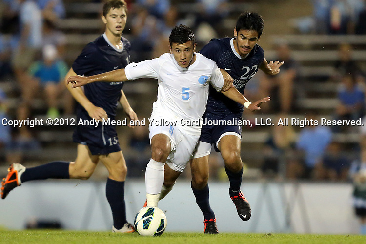 02 October 2012: UNC's Mikey Lopez (5) and Georgia Southern's Seth Prieto (22). The University of North Carolina Tar Heels defeated the Georgia Southern Eagles 2-0 at Fetzer Field in Chapel Hill, North Carolina in a 2012 NCAA Division I Men's Soccer game.