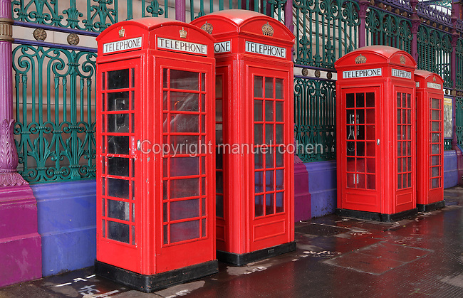 Red telephone boxes at the entrance of Smithfield or London Central Markets, 19th century, London, UK. Picture by Manuel Cohen
