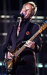 "46TH ANNUAL GRAMMY AWARDS -- Sting performs ""I Saw Her Standing There,"" in a tribute to the Beatles during the 46th Annual Grammy Awards show, at the Staples Center in Los Angeles, Calif., Sunday, Feb. 8, 2004. LOS ANGELES TIMES PHOTO BY RICHARD HARTOG"