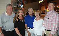 Titim (from left) and Debbie Ogg, Gary Gray and wife city councilor Adella Gray and Judge John Threet gather at the Red, White and Baby Blue event benefitting the Jackson Graves Foundation hosted at The Garden Room on June 24.
