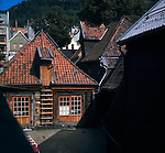 Wooden fronted buildings against tiled roofs in Bergen, Norway.