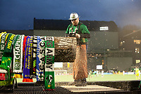 PORTLAND, OR - MARCH 01: Timber Joey cuts a slab off the Victory Log after the Portland Timbers scored a goal during a game between Minnesota United FC and Portland Timbers at Providence Park on March 01, 2020 in Portland, Oregon.
