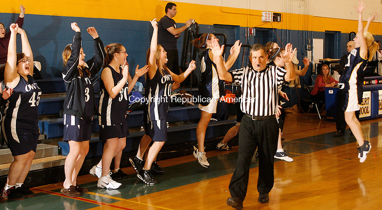 Winsted, CT-18 December 18 2008-121808MK01 As regulation time expired the Oliver Wolcott Technical High School girls varsity basketball team celebrates their first victory ever.  One parent said it had been 13 years.  Oliver Wolcott defeat Gilbert 54 - 43 at Gilbert High School Thursday evening. Michael Kabelka / Republican-American