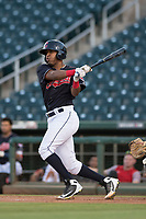 AZL Indians 1 catcher Eric Rodriguez (12) follows through on his swing during an Arizona League game against the AZL White Sox at Goodyear Ballpark on June 20, 2018 in Goodyear, Arizona. AZL Indians 1 defeated AZL White Sox 8-7. (Zachary Lucy/Four Seam Images)