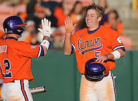 Mike Freeman (5) is congratulated after scoring a run in a game between the Charlotte 49ers and Clemson Tigers Feb. 20, 2009, at Doug Kingsmore Stadium in Clemson, S.C. (Photo by: Tom Priddy/Four Seam Images)