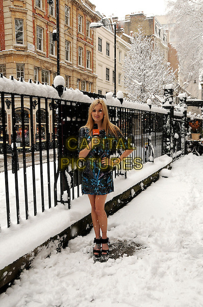FEARNE COTTON.Launching Orange red carpet program, Piccadilly, London, England..February 2nd, 2009.full length weather blue black dress hand on hip microphone snow snowing .CAP/CAS.©Bob Cass/Capital Pictures.
