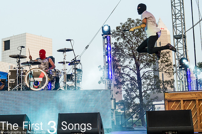 Tyler Joseph and Josh Dun of twenty | one | pilots performs at the 2014 AP Music Awards at the Rock And Roll Hall Of Fame and Museum at North Coast Harbor in Cleveland, Ohio.