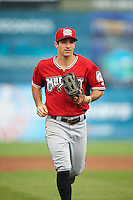 Carolina Mudcats right fielder Keith Curcio (9) jogs to the dugout in between innings during a game against the Frederick Keys on June 4, 2016 at Nymeo Field at Harry Grove Stadium in Frederick, Maryland.  Frederick defeated Carolina 5-4 in eleven innings.  (Mike Janes/Four Seam Images)