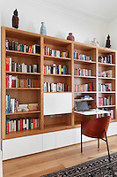 A wooden bookcase unit with built-in cupboards below. The unit has a pull-down desk, which provides a useful workspace.