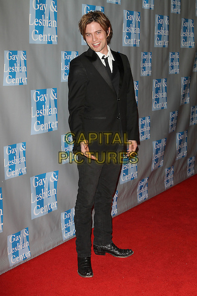 "JACKSON RATHBONE.L.A. Gay & Lesbian Center's ""An Evening With Women"" held at The Beverly Hilton Hotel, Beverly Hills, California, USA..April 16th, 2011.full length  hand black suit.CAP/ADM/KB.©Kevan Brooks/AdMedia/Capital Pictures."