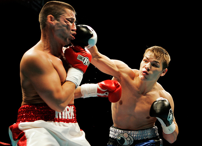 Fedor Chudinov of Siberia, Russia, right, delivers a first-round knockout punch to Shawn Kirk, left, of Lexington, Ky. during the Summer Showdown boxing match at the Reno Events Center in Reno, Nev., Friday, July 10, 2009.