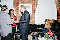 Former Virginia governor and Republican presidential candidate Jim Gilmore speaks with Gary LaBella, of Arlington, Virginia, (checkered shirt) and Lauren Green, of Silver Spring, Maryland, a Master's student in Political Communications at American University, at the Gilmore primary watch party at Fratello's in Manchester, New Hampshire on the day of primary voting, Feb. 9, 2016. LaBella came to the party because he said Gilmore was a good governor in Virginia. He was in the state for the primary acting as a chaperone for American University students visiting to watch the process. Gilmore finished in last place among major Republican candidates still in the race with a total of 150 votes.