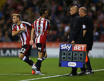 Stefan Scougall of Sheffield Utd is replaced by Harry Chapman of Sheffield Utd during the League One match at Bramall Lane Stadium, Sheffield. Picture date: September 27th, 2016. Pic Simon Bellis/Sportimage