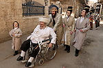Israel, Jerusalem. Purim holiday at the Me?a She?arim quarter, clebrating family on the way to the synagogue<br />