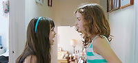 Actors Rachel Arianna Weintraub (l) as Young Jane and Alanna Peyton Smith as Young Cory, the sisters in Lies I Told My Little Sister feature film