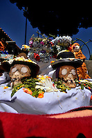 Skull day in La Paz city cemetery, Bolivia. Believing that skulls are part of their home and bring good luck for business and love, people every November 8th look for their ancestor´s skull to take them to mass and to spend a day in the open. This year the  Catholic priest of the cemetery, following Catholic Church disdain to this cult, decided not to open the little chapel of the place. But the pressure of the faithful ones was unbearable and he was forced to open and celebrate sunday mass.   <br />