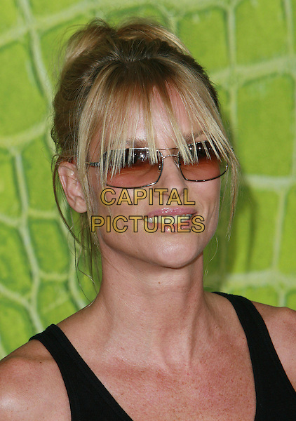 NICOLLETTE SHERIDAN.Motorola's 8th Anniversary Party held at the Hollywood Palladium, Hollywood, California, USA, .2 November 2006..portrait headshot black vest top sunglasses fringe hair up Nicolette.Ref: ADM/CH.www.capitalpictures.com.sales@capitalpictures.com.©Charles Harris/AdMedia/Capital Pictures.