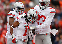 Ohio State Buckeyes cornerback Bradley Roby (1) is congratulated by Ohio State Buckeyes defensive back Tyvis Powell (23) after scoring a touchdown in the first half of Saturday's NCAA Division I football game against Illinois at Memorial Stadium in Champaign, Il., on November 16, 2013. Ohio State won the game 60-35. (Barbara J. Perenic/The Columbus Dispatch)