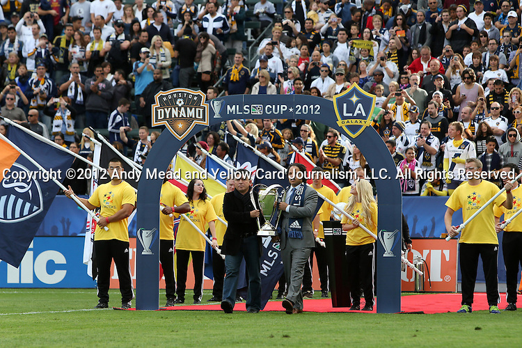 01 December 2012: Los Angeles Galaxy legends Mauricio Cienfuegos (SLV) and Cobi Jones carry the Philip F. Anschutz Trophy onto the field. The Los Angeles Galaxy played the Houston Dynamo at the Home Depot Center in Carson, California in MLS Cup 2012. Los Angeles won the game 3-1.