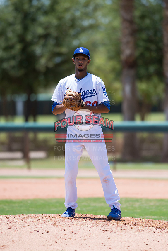 AZL Dodgers relief pitcher Edward Cuello (60) checks the runner at third base during an Arizona League game against the AZL Padres 2 at Camelback Ranch on July 4, 2018 in Glendale, Arizona. The AZL Dodgers defeated the AZL Padres 2 9-8. (Zachary Lucy/Four Seam Images)