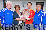 Sandra Heffernan, Killarney, pictured as she presented the Johnny Heffernan Memorial Shield to Underage Player of the Tournament Liam Carey, Beaufort, from the Killarney Credit Union Killarney Athletic seven a side tournament in Woodlawn Park on Thursday. Also pictured are  Don O'Donoghue, chairman Killarney Athletic and Basil Sheerin, Killarney Athletic.