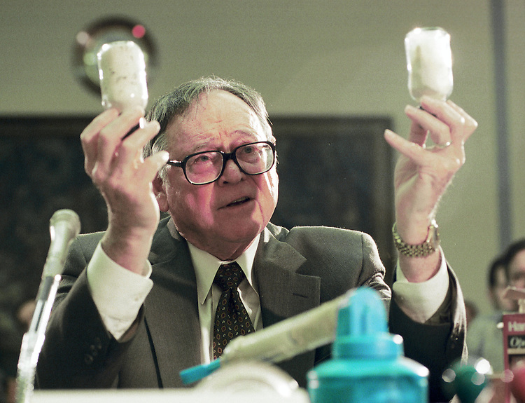 3/3/99.INTERNATIONAL BIOLOGICAL WARFARE--Dr. William Patrick, former chief of the Product Division of the former offensive biological weapons program of the United States, holds a vial containing one of the ingredients of anthrax and another containing a powder as he explains to the House Select Intelligence Committee how biological weapons would be implemented..CONGRESSIONAL QUARTERLY PHOTO BY SCOTT J. FERRELL