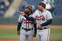 Hitting coach Bobby Moore (1), left, and coach Wiggy Nevarez (22) of the Rome Braves talk before a game against the Greenville Drive on Saturday, April 20, 2019, at Fluor Field at the West End in Greenville, South Carolina. Rome won, 5-4. (Tom Priddy/Four Seam Images)