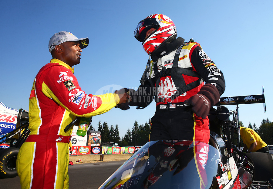 Aug. 3, 2014; Kent, WA, USA; NHRA top fuel dragster driver Antron Brown (left) congratulates Doug Kalitta after winning the Northwest Nationals at Pacific Raceways. Mandatory Credit: Mark J. Rebilas-USA TODAY Sports