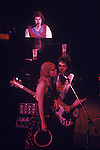"Paul and Linda McCartney Wings Tour 1975. Paul Linda nd Denny Laine, Liverpool. England. The photographs from this set were taken in 1975. I was on tour with them for a children's ""Fact Book"". This book was called, The Facts about a Pop Group Featuring Wings. Introduced by Paul McCartney, published by G.Whizzard. They had recently recorded albums, Wildlife, Red Rose Speedway, Band on the Run and Venus and Mars. I believe it was the English leg of Wings Over the World tour. But as I recall they were promoting,  Band on the Run and Venus and Mars in particular."