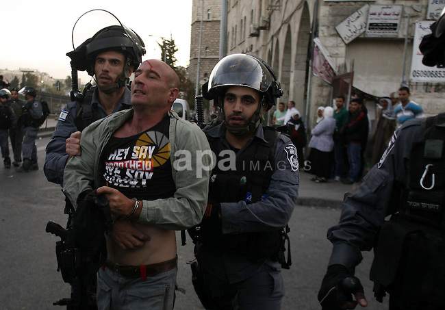 Israeli police Prevented Palestinian demonstrators as they try to disperse a protest against a parade marking Jerusalem Day, in front of Damascus Gate outside Jerusalem's Old City May 20, 2012. Jerusalem Day marks the anniversary of Israel's capture of the Eastern part of the city during the 1967 Middle East War. In 1980, Israel's parliament passed a law declaring united Jerusalem as the nationally. Photo by Muammar Awad