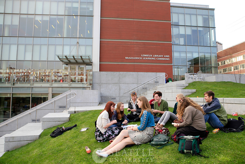 04022012-  Students enjoy a warm spring day while hanging outside the Library on campus.