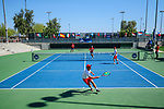 SURPRISE, AZ - MAY 12: Filip Zupancic of the Barry Buccaneers return a ball against Alvaro Regalado and Zach Whaanga of the Columbus State Cougars as teammate Fernando Tous looks on during the Division II Men's Tennis Championship held at the Surprise Tennis & Racquet Club on May 12, 2018 in Surprise, Arizona. (Photo by Jack Dempsey/NCAA Photos via Getty Images)