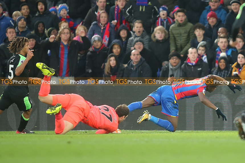 Asmir Begovic of Bournemouth fouls Wilfried Zaha of Crystal Palace to concede a penalty during Crystal Palace vs AFC Bournemouth, Premier League Football at Selhurst Park on 9th December 2017