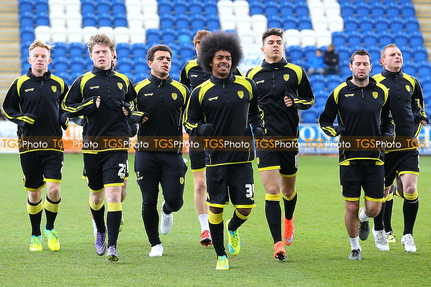 Burton players warm up ahead of the start of Colchester United vs Burton Albion, Sky Bet League 1 Football at the Weston Homes Community Stadium on 23rd April 2016