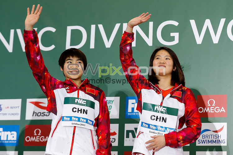 Picture by Rogan Thomson/SWpix.com - 01/05/2015 - Diving - 2015 FINA/NVC Diving World Series - London Aquatics Centre, London, England - Chen Ruolin and Hiixia Liu of China (Gold) celebrate on the podium for the Womens 10m Synchro Platform Final.