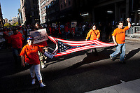 NEW YORK, NY - MAY 01: People take part  during a march as part of May Day rallies on May 1, 2013 in New York City. Rallies and marches are occuring throughout the city today to mark the day which is traditionally associated with workers movements. (Photo by Kena Betancur).