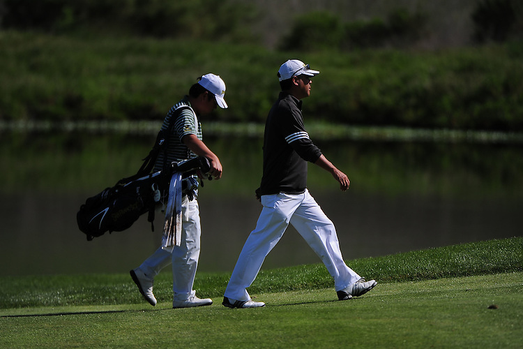 April 18, 2012; Hollister, CA, USA; San Francisco Dons men's golf coach Rich Yokota (right) and golfer James Back (left) during the WCC Golf Championships at San Juan Oaks Golf Club.