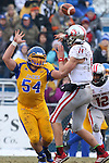 BROOKINGS, SD - NOVEMBER 22:  Cole Langer #54 from South Dakota State University applies pressure to Kevin Earl #14 from the University of South Dakota in the first half of their game Saturday at Coughlin Alumni Stadium in Brookings. (Photo by Dave Eggen/Inertia)