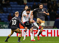 Bolton Wanderers' Jason Lowe competing with Sheffield Wednesday's Atdhe Nuhiu <br /> <br /> Photographer Andrew Kearns/CameraSport<br /> <br /> The EFL Sky Bet Championship - Bolton Wanderers v Sheffield Wednesday - Tuesday 12th March 2019 - University of Bolton Stadium - Bolton<br /> <br /> World Copyright © 2019 CameraSport. All rights reserved. 43 Linden Ave. Countesthorpe. Leicester. England. LE8 5PG - Tel: +44 (0) 116 277 4147 - admin@camerasport.com - www.camerasport.com